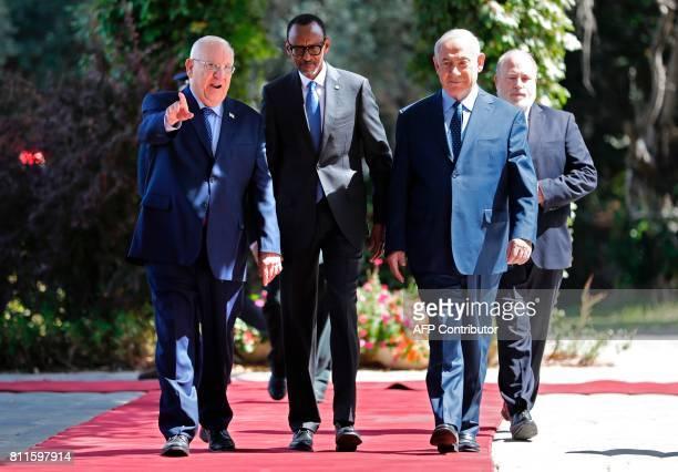 Rwanda's President Paul Kagame walks alongside Israeli Prime Minister Benjamin Netanyahu and Israeli President Reuven Rivlin during a welcome...