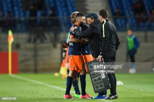 Ryad Boudebouz and Jean Louis Gasset Coach of Montpellier during the Ligue 1 match between Montpellier Herault SC and Fc Lorient at Stade de la...