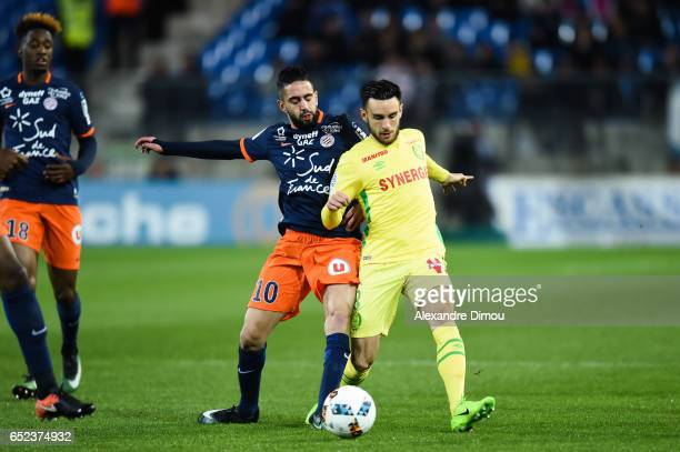 Ryad Boudebouz of Montpellier and Adrien Thomasson of Nantes during the Ligue 1 match between Montpellier Herault and Fc Nantes at Stade de la Mosson...
