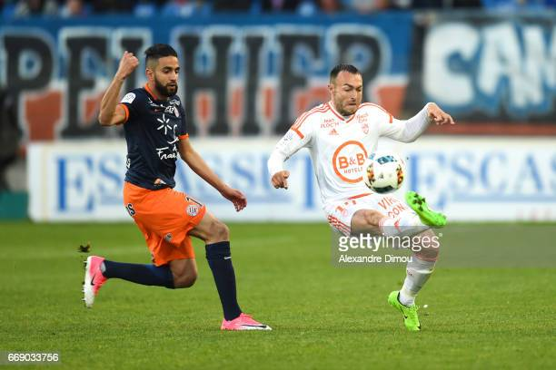 Ryad Boudebouz of Montpellier and Romain Philippoteaux of Lorient during the Ligue 1 match between Montpellier Herault SC and Fc Lorient at Stade de...