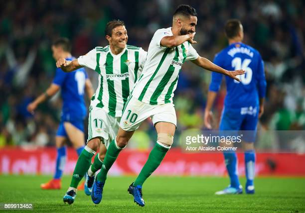 Ryad Boudebouz of Real Betis Balompie celebrates after scoring the seconf goal for Real Betis Balompie during the La Liga match between Real Betis...