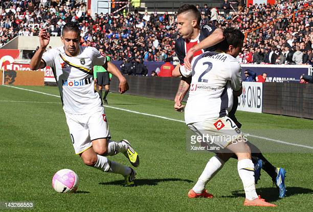 Ryad Boudebouz Sebastien Corchia of Sochaux Montbeliard and Jeremy Menez of Paris SaintGermain FC during the French League 1 match between Paris...