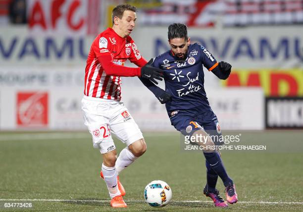 Ryad Montpellier's French midfielder Ryad Boudebouz drives the ball next to Nancy's French midfielder Benoit Pedretti during the French L1 football...