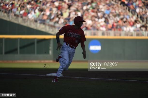 Ryan Aguillar of University of Arizona rounds third base and attempts to score against Coastal Carolina University during the Division I Men's...
