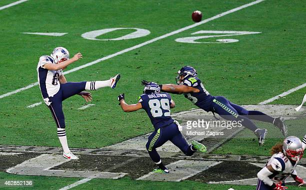 Ryan Allen of the New England Patriots punts under pressure during the game against the Seattle Seahawks at the University of Phoenix Stadium on...