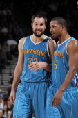 Ryan Anderson and Dominic McGuire of the New Orleans Hornets in a game against the Golden State Warriors on December 18 2012 at Oracle Arena in...