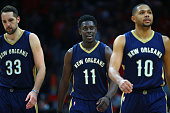 Ryan Anderson Jrue Holiday and Eric Gordon of the New Orleans Pelicans walk upcourt during a break in their NBA game against the Los Angeles Clippers...