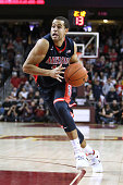 Ryan Anderson of the Arizona Wildcats drives to the basket against the USC Trojans during a NCAA Pac12 college basketball game at Galen Center on...