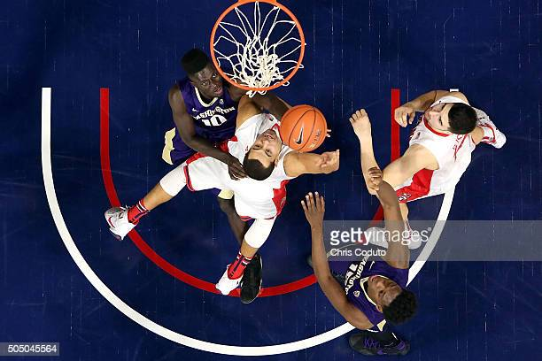 Ryan Anderson of the Arizona Wildcats shoots over Malik Dime of the Washington Huskies during the first half of the college basketball game at McKale...