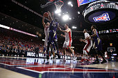 Ryan Anderson of the Arizona Wildcats shoots over Noah Dickerson of the Washington Huskies during the first half of the college basketball game at...