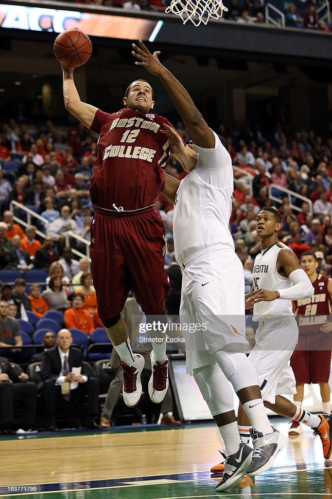 Ryan Anderson #12 of the Boston College Eagles goes to the hoop against Reggie Johnson #42 of the Miami Hurricanes during the quarterfinals of the ACC Men's Basketball Tournament at the Greensboro Coliseum on March 15, 2013 in Greensboro, North Carolina.
