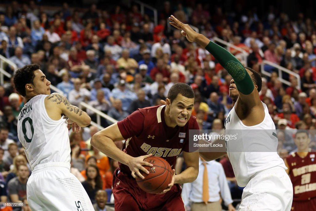 Ryan Anderson #12 of the Boston College Eagles handles the ball against Shane Larkin #0 and Kenny Kadji #35 of the Miami Hurricanes during the quarterfinals of the ACC Men's Basketball Tournament at the Greensboro Coliseum on March 15, 2013 in Greensboro, North Carolina.