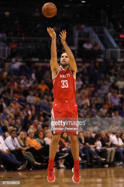 Ryan Anderson of the Houston Rockets attempts a shot against the Phoenix Suns during the first half of the NBA game at Talking Stick Resort Arena on...
