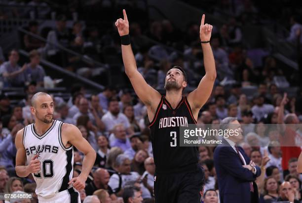 Ryan Anderson of the Houston Rockets celebrates a threepoint shot in front of Manu Ginobili of the San Antonio Spurs during Game One of the NBA...