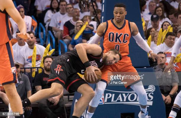 Ryan Anderson of the Houston Rockets runs into Russell Westbrook of the Oklahoma City Thunder during the second half of Game Four in the 2017 NBA...