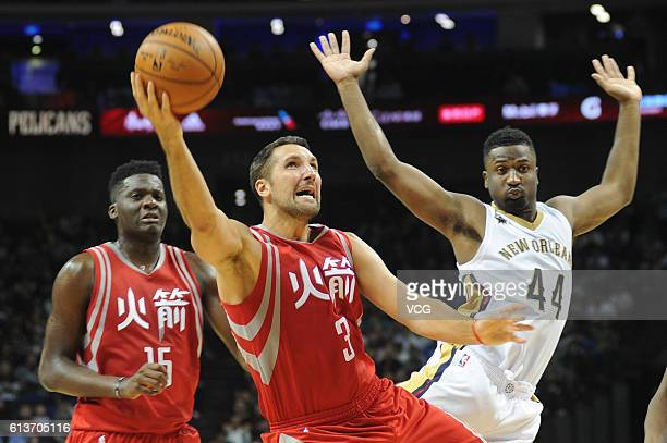 Ryan Anderson of the Houston Rockets shoots the ball against Solomon Hill of the New Orleans Pelicans during the preseason game as part of the 2016...
