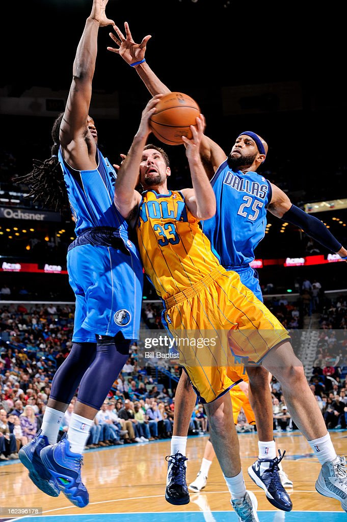 Ryan Anderson #33 of the New Orleans Hornets attempts a shot against <a gi-track='captionPersonalityLinkClicked' href=/galleries/search?phrase=Vince+Carter&family=editorial&specificpeople=201488 ng-click='$event.stopPropagation()'>Vince Carter</a> #25 and <a gi-track='captionPersonalityLinkClicked' href=/galleries/search?phrase=Jae+Crowder&family=editorial&specificpeople=7357507 ng-click='$event.stopPropagation()'>Jae Crowder</a> #9 of the Dallas Mavericks on February 22, 2013 at the New Orleans Arena in New Orleans, Louisiana.
