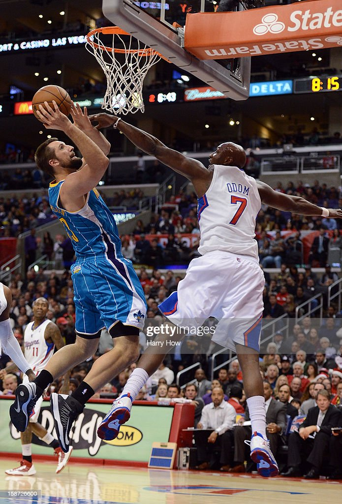 Ryan Anderson #33 of the New Orleans Hornets attempts a shot in front of <a gi-track='captionPersonalityLinkClicked' href=/galleries/search?phrase=Lamar+Odom&family=editorial&specificpeople=201519 ng-click='$event.stopPropagation()'>Lamar Odom</a> #7 of the Los Angeles Clippers during a 93-77 Clipper victory for their 11th straight win at Staples Center on December 19, 2012 in Los Angeles, California.