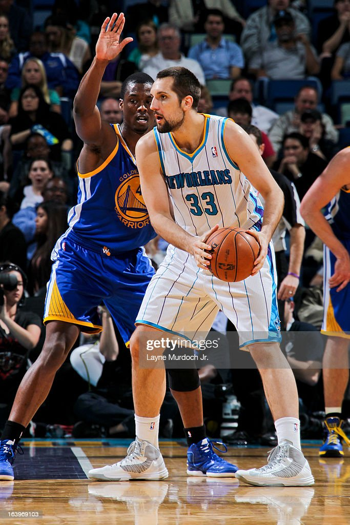 Ryan Anderson #33 of the New Orleans Hornets controls the ball against Harrison Barnes #40 of the Golden State Warriors on March 18, 2013 at the New Orleans Arena in New Orleans, Louisiana.