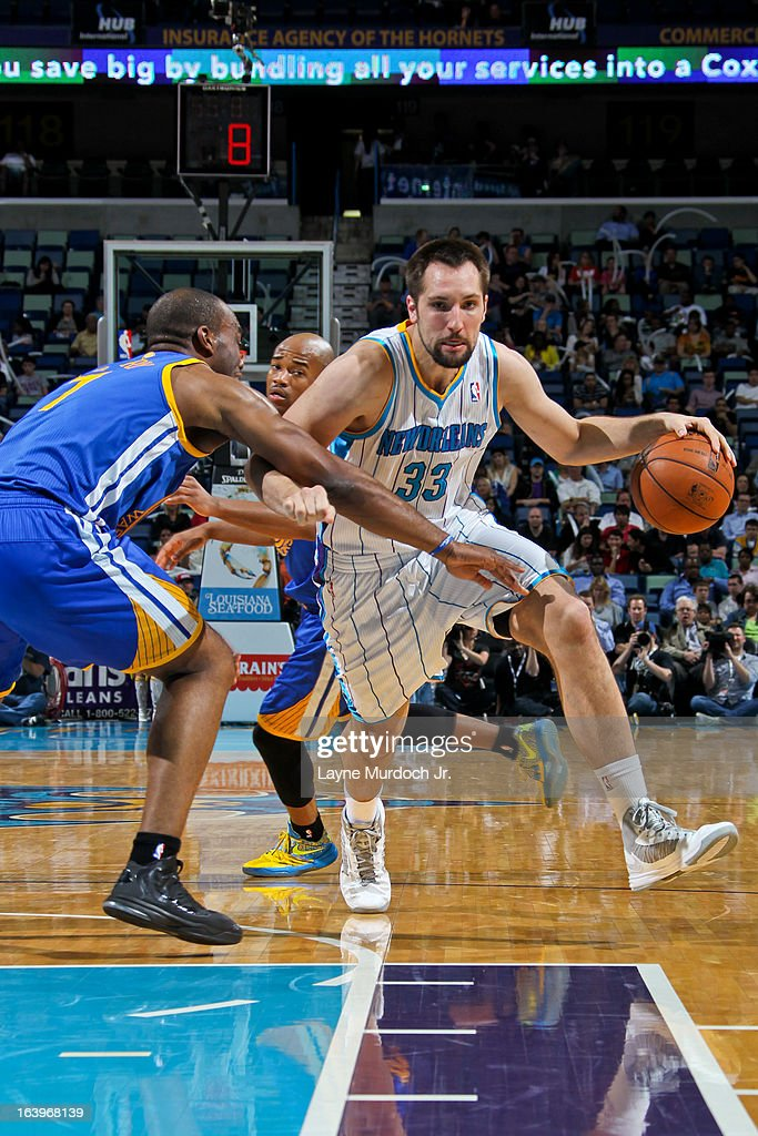 Ryan Anderson #33 of the New Orleans Hornets drives against Carl Landry #7 of the Golden State Warriors on March 18, 2013 at the New Orleans Arena in New Orleans, Louisiana.