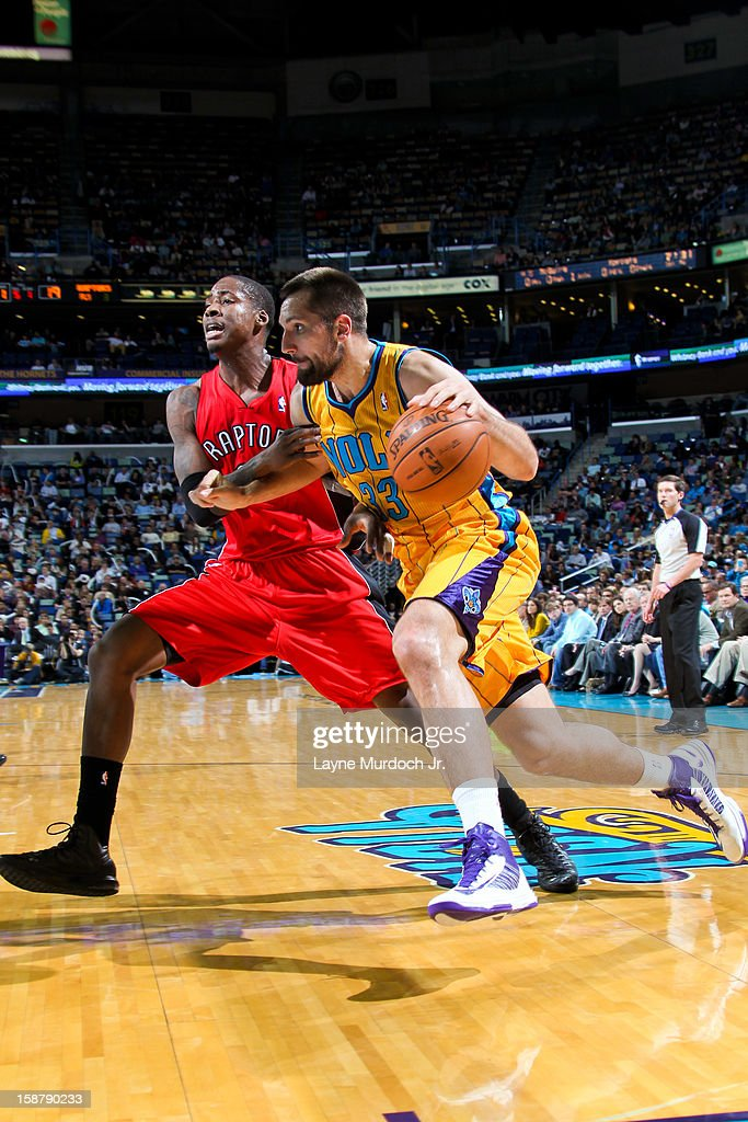 Ryan Anderson #33 of the New Orleans Hornets drives against Ed Davis #32 of the Toronto Raptors on December 28, 2012 at the New Orleans Arena in New Orleans, Louisiana.
