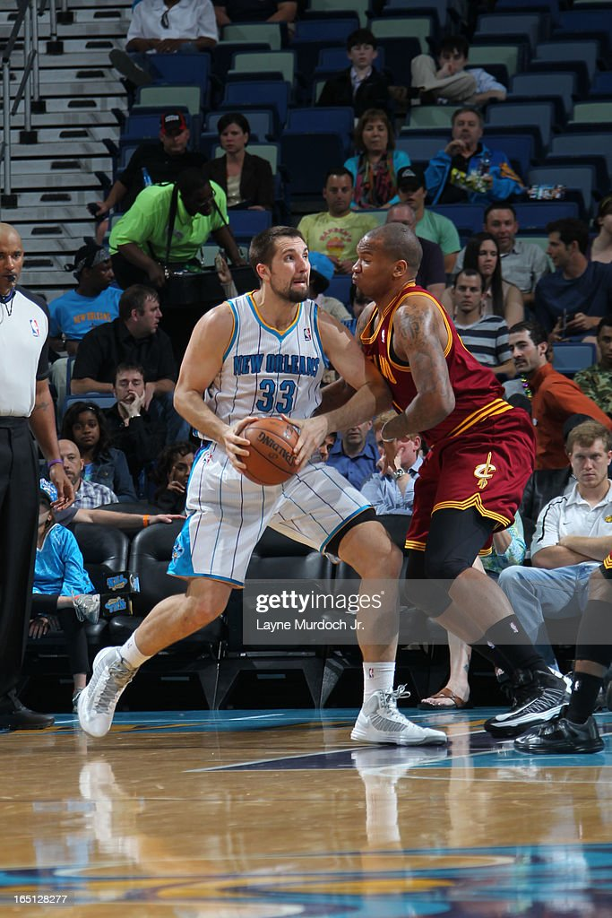 Ryan Anderson #33 of the New Orleans Hornets drives against Marreese Speights #15 of the Cleveland Cavaliers on March 31, 2013 at the New Orleans Arena in New Orleans, Louisiana.
