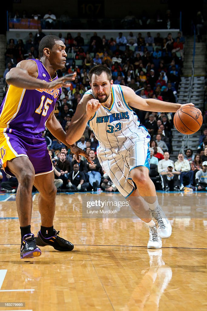 Ryan Anderson #33 of the New Orleans Hornets drives against Metta World Peace #15 of the Los Angeles Lakers on March 6, 2013 at the New Orleans Arena in New Orleans, Louisiana.