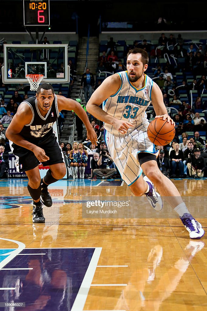 Ryan Anderson #33 of the New Orleans Hornets drives ahead of Boris Diaw #33 of the San Antonio Spurs on January 7, 2013 at the New Orleans Arena in New Orleans, Louisiana.