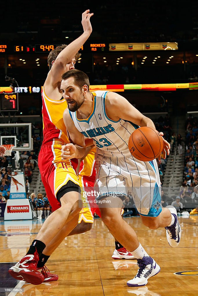 Ryan Anderson #33 of the New Orleans Hornets drives the ball around <a gi-track='captionPersonalityLinkClicked' href=/galleries/search?phrase=Omer+Asik&family=editorial&specificpeople=4946055 ng-click='$event.stopPropagation()'>Omer Asik</a> #3 of the Houston Rockets at New Orleans Arena on January 9, 2013 in New Orleans, Louisiana. The Hornets defeated the Rockets 88-79.