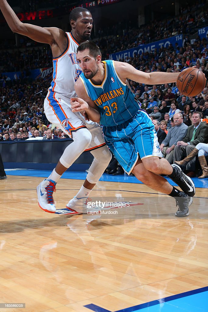 Ryan Anderson #33 of the New Orleans Hornets drives to the basket against <a gi-track='captionPersonalityLinkClicked' href=/galleries/search?phrase=Kevin+Durant&family=editorial&specificpeople=3847329 ng-click='$event.stopPropagation()'>Kevin Durant</a> #35 of the Oklahoma City Thunder on February 27, 2013 at the Chesapeake Energy Arena in Oklahoma City, Oklahoma.