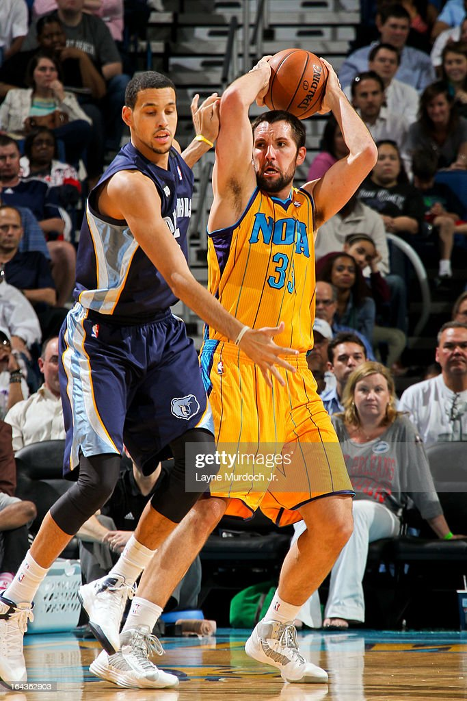 Ryan Anderson #33 of the New Orleans Hornets looks to pass the ball against <a gi-track='captionPersonalityLinkClicked' href=/galleries/search?phrase=Austin+Daye&family=editorial&specificpeople=4682416 ng-click='$event.stopPropagation()'>Austin Daye</a> #5 of the Memphis Grizzlies on March 22, 2013 at the New Orleans Arena in New Orleans, Louisiana.