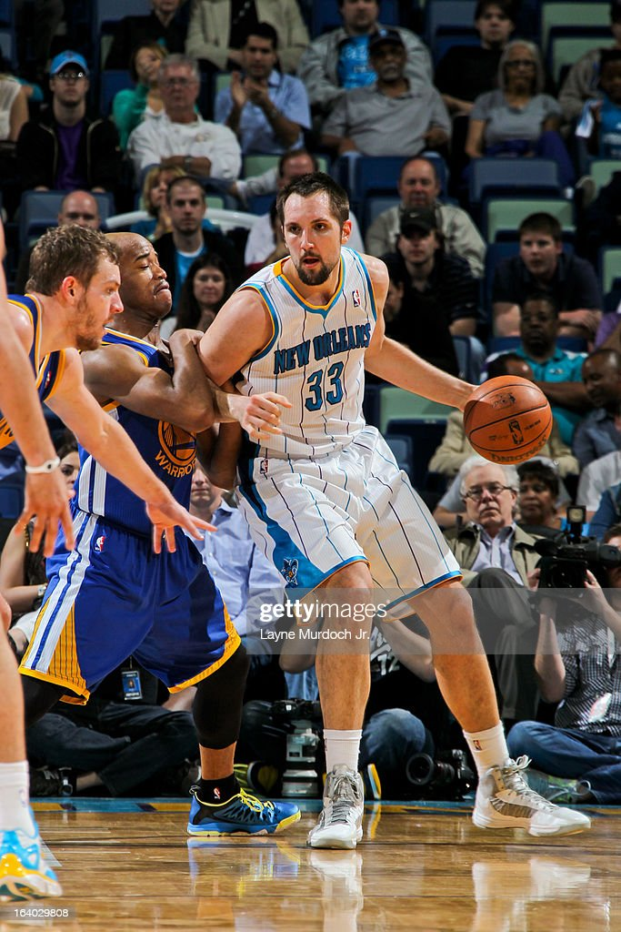 Ryan Anderson #33 of the New Orleans Hornets posts-up against Jarrett Jack #2 of the Golden State Warriors on March 18, 2013 at the New Orleans Arena in New Orleans, Louisiana.