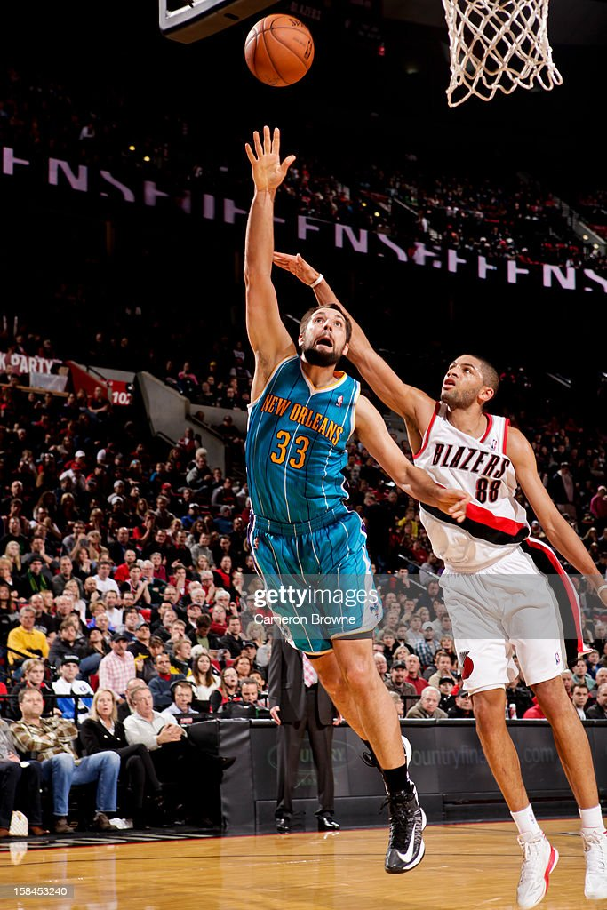 Ryan Anderson #33 of the New Orleans Hornets shoots a layup against <a gi-track='captionPersonalityLinkClicked' href=/galleries/search?phrase=Nicolas+Batum&family=editorial&specificpeople=3746275 ng-click='$event.stopPropagation()'>Nicolas Batum</a> #88 of the Portland Trail Blazers on December 16, 2012 at the Rose Garden Arena in Portland, Oregon.