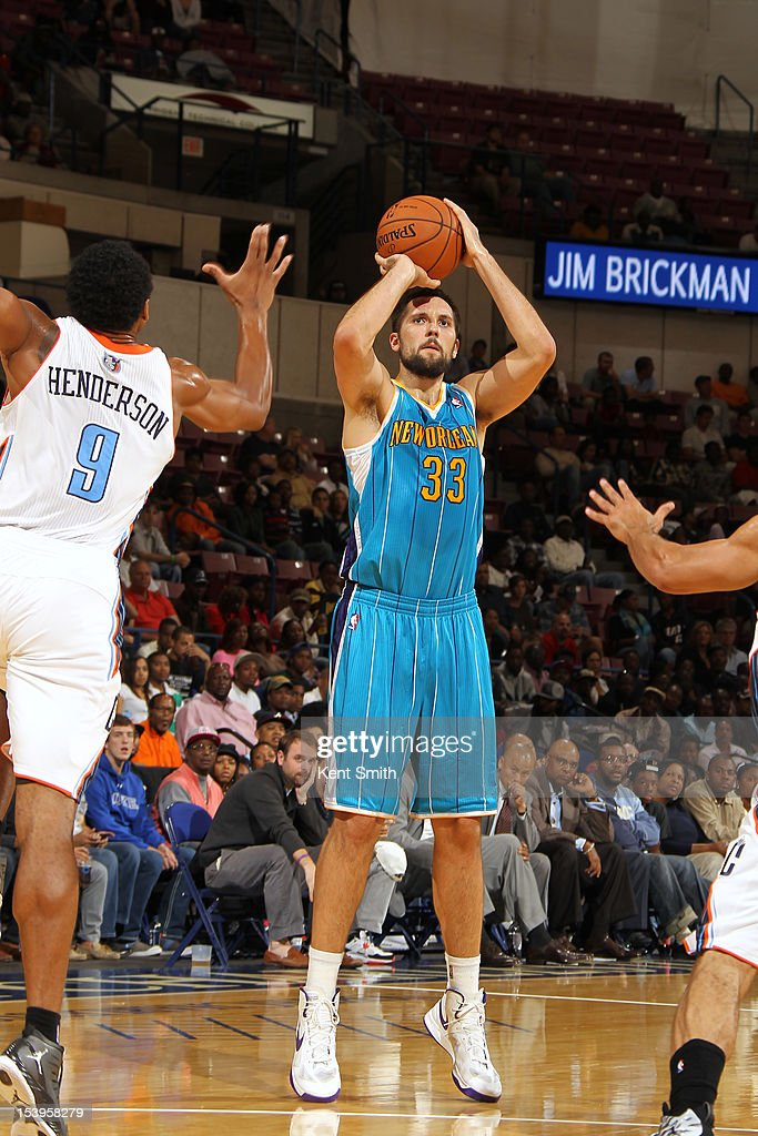Ryan Anderson #33 of the New Orleans Hornets shoots a three pointer against Gerald Henderson #9 of the Charlotte Bobcats at the North Charleston Coliseum on October 11, 2012 in North Charleston, South Carolina.