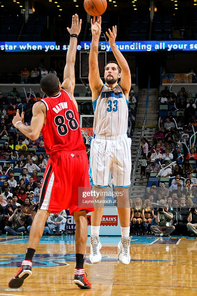 Ryan Anderson #33 of the New Orleans Hornets shoots a three-pointer against <a gi-track='captionPersonalityLinkClicked' href=/galleries/search?phrase=Nicolas+Batum&family=editorial&specificpeople=3746275 ng-click='$event.stopPropagation()'>Nicolas Batum</a> #88 of the Portland Trail Blazers on March 10, 2013 at the New Orleans Arena in New Orleans, Louisiana.