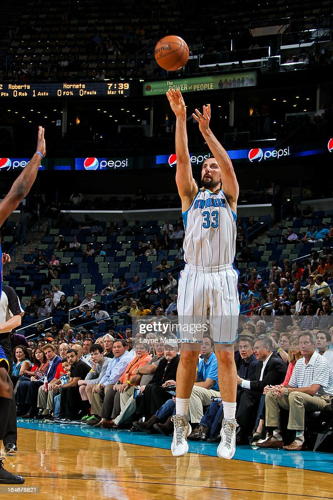 Ryan Anderson #33 of the New Orleans Hornets shoots a three-pointer against the Golden State Warriors on March 18, 2013 at the New Orleans Arena in New Orleans, Louisiana.