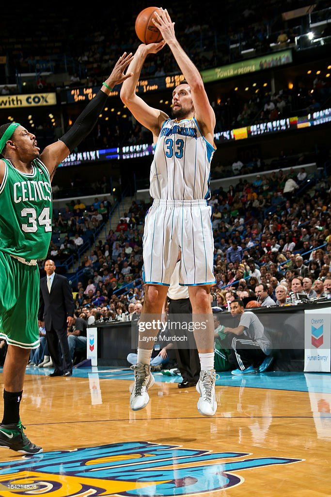 Ryan Anderson #33 of the New Orleans Hornets shoots against <a gi-track='captionPersonalityLinkClicked' href=/galleries/search?phrase=Paul+Pierce&family=editorial&specificpeople=201562 ng-click='$event.stopPropagation()'>Paul Pierce</a> #34 of the Boston Celtics on March 20, 2013 at the New Orleans Arena in New Orleans, Louisiana.
