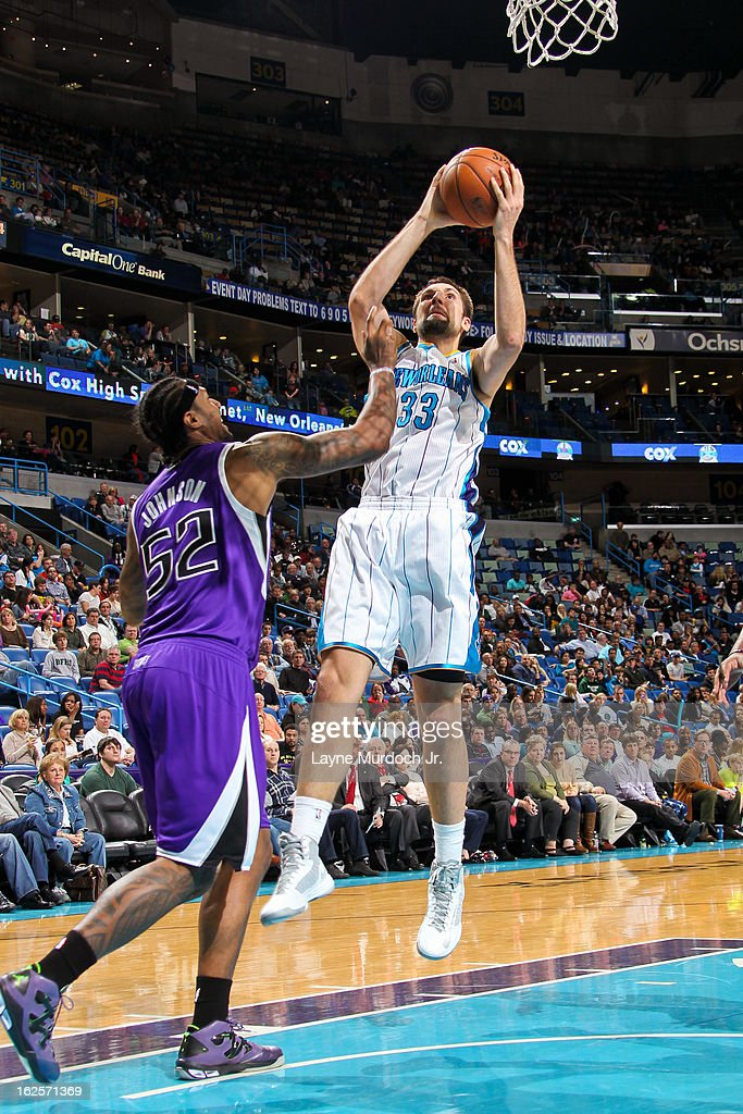 Ryan Anderson #33 of the New Orleans Hornets shoots in the lane against James Johnson #52 of the Sacramento Kings on February 24, 2013 at the New Orleans Arena in New Orleans, Louisiana.