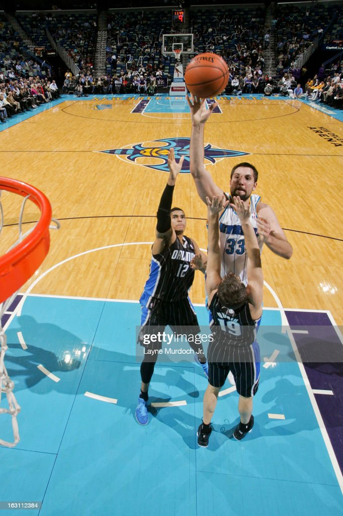 Ryan Anderson #33 of the New Orleans Hornets shoots in the lane against <a gi-track='captionPersonalityLinkClicked' href=/galleries/search?phrase=Beno+Udrih&family=editorial&specificpeople=202616 ng-click='$event.stopPropagation()'>Beno Udrih</a> #19 and Tobias Harris #12 of the Orlando Magic on March 4, 2013 at the New Orleans Arena in New Orleans, Louisiana.