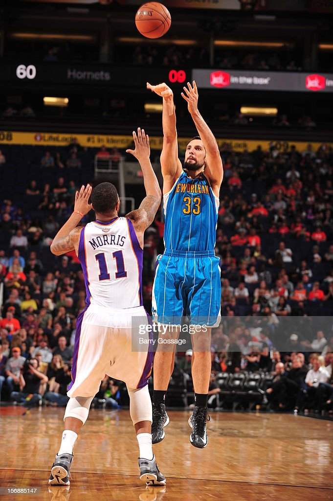 Ryan Anderson #33 of the New Orleans Hornets shoots over <a gi-track='captionPersonalityLinkClicked' href=/galleries/search?phrase=Markieff+Morris&family=editorial&specificpeople=5293881 ng-click='$event.stopPropagation()'>Markieff Morris</a> #11 of the Phoenix Suns on November 23, 2012 at U.S. Airways Center in Phoenix, Arizona.