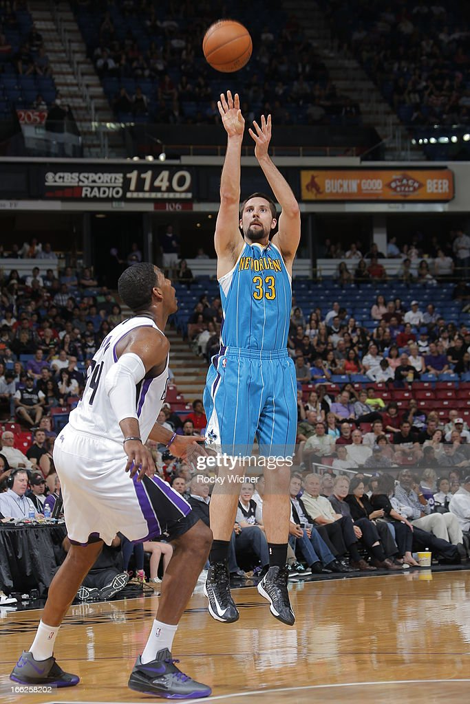 Ryan Anderson #33 of the New Orleans Hornets shoots the ball against Jason Thompson #34 of the Sacramento Kings on April 10, 2013 at Sleep Train Arena in Sacramento, California.