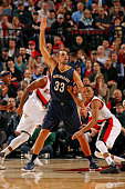 Ryan Anderson of the New Orleans Pelicans calls for the ball while defended by Tim Frazier of the Portland Trail Blazers on December 14 2015 at the...