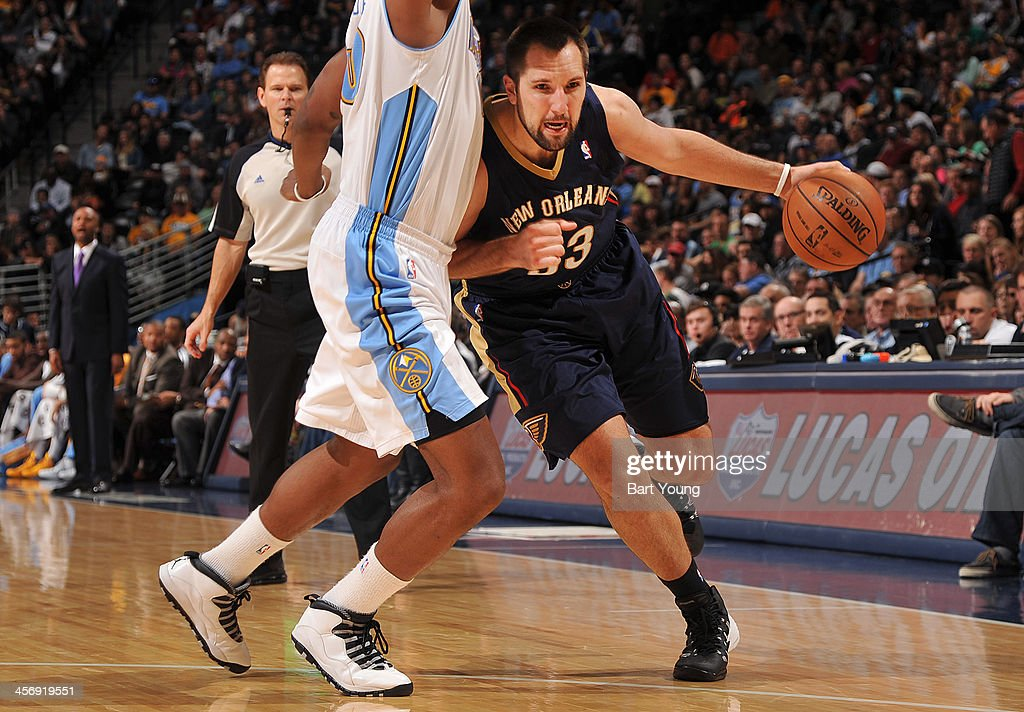 Ryan Anderson #33 of the New Orleans Pelicans dribbles to the basket against the Denver Nuggets on December 15, 2013 at the Pepsi Center in Denver, Colorado.