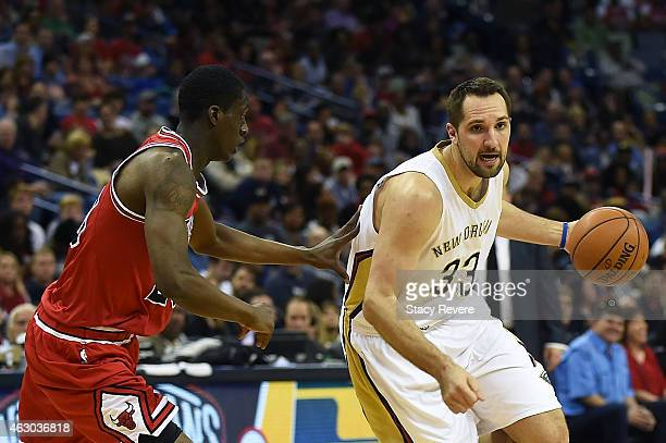 Ryan Anderson of the New Orleans Pelicans drives around Tony Snell of the Chicago Bulls during the first half of a gameat the Smoothie King Center on...