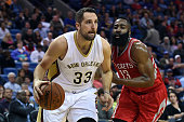 Ryan Anderson of the New Orleans Pelicans drives to the basket against James Harden of the Houston Rockets during the first half of a game at the...