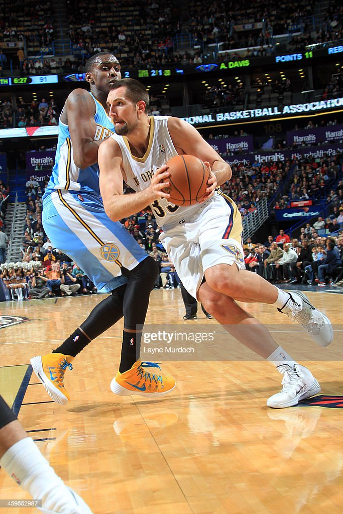 Ryan Anderson #33 of the New Orleans Pelicans drives to the basket against the Denver Nuggets on December 27, 2013 at the New Orleans Arena in New Orleans, Louisiana.