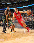 Ryan Anderson of the New Orleans Pelicans drives to the basket against the Utah Jazzduring the game on December 16 2014 at Smoothie King Center in...