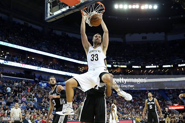 Ryan Anderson of the New Orleans Pelicans dunks the ball against the San Antonio Spurs at Smoothie King Center on December 26 2014 in New Orleans...