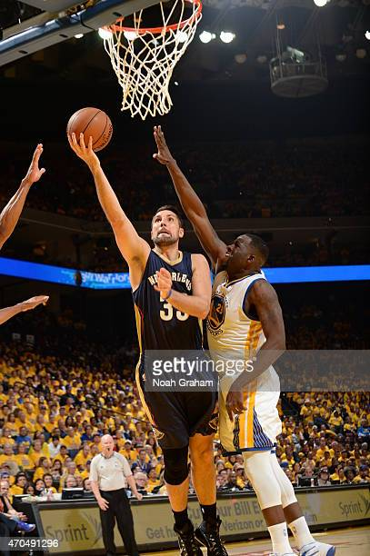 Ryan Anderson of the New Orleans Pelicans goes to the basket against Draymond Green of the Golden State Warriors in Game Two of the Western...