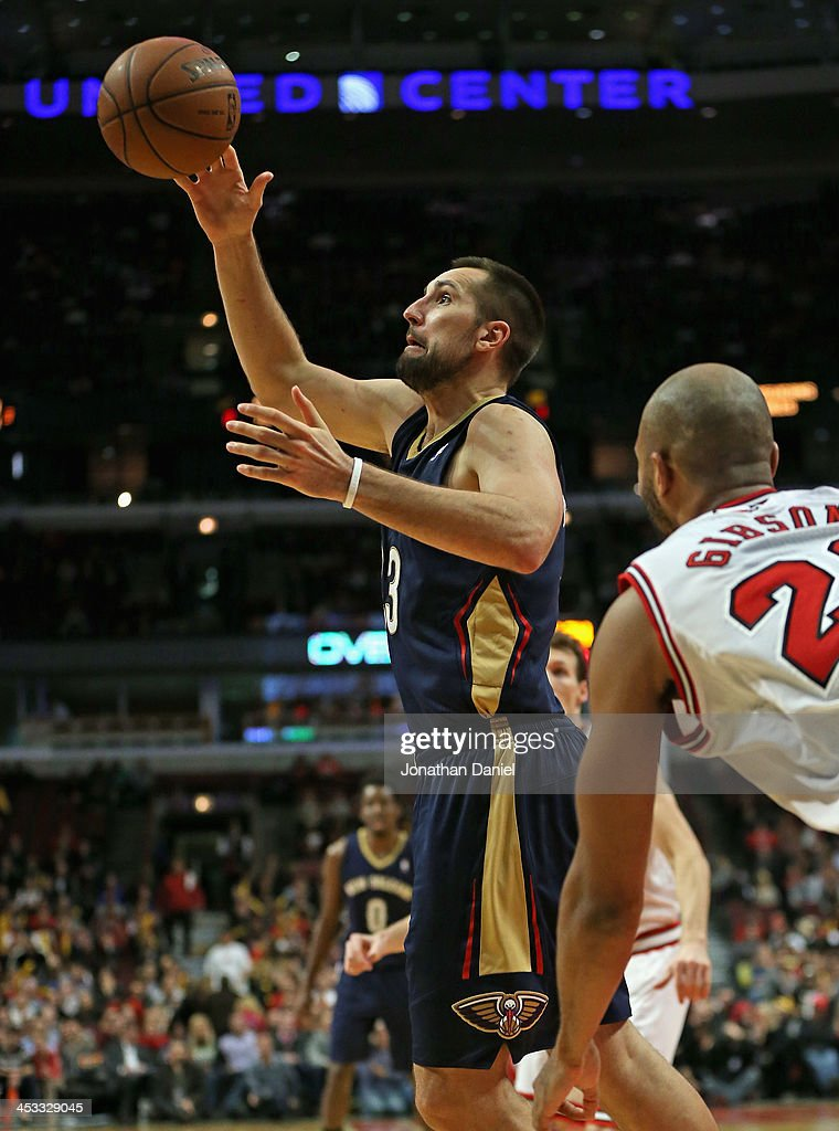 Ryan Anderson #33 of the New Orleans Pelicans grabs a loose ball against the Chicago Bulls at the United Center on December 2, 2013 in Chicago, Illinois. The Pelicans defeated the Bulls 131-128 in triple overtime.